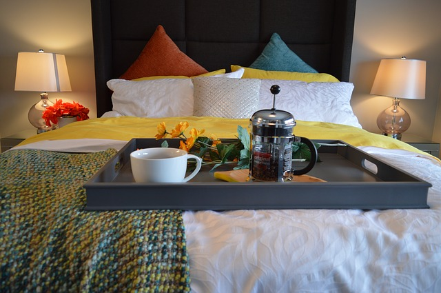 Cup of tea on a hotel bed