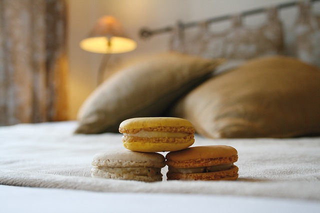 Macarons on a hotel bed